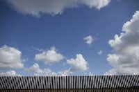 This section of border fence stands in Rio Grande City. The Rio Grande Valley is the epicenter of state and federal border security efforts. (2015 File Photo/Bloomberg News)