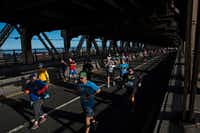 Runners cross the Queensboro Bridge, where Patrick Pownell and Brad Gamble met up after being separated while racing the New York City Marathon. Nov. 6, 2016.(NYT/Christian Hansen)