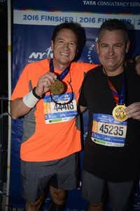 "Dallas plastic surgeon and runner Patrick Pownell (left) waited for his friend and fellow surgeon Brad Gamble when the two ran the New York City marathon in early November. Pownell was having a strong race, but he waited for his friend. ""I will always be grateful for making that choice,"" he says.(Dawn Pownell)"