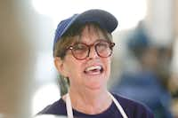 """Debbie Johnson has earned a following among those who frequent the cafe's morning service. """"I'm like mold,"""" she jokes. """"I grow on people.""""(Nathan Hunsinger/Staff Photographer)"""