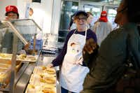Johnson says the volunteer shifts as less like work and more like feeding her friends.(Nathan Hunsinger/Staff Photographer)