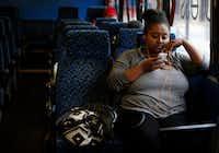 Saliana Girmai waits aboard the Metro ArlingtonXpress bus at College Park Center in Arlington on Nov. 22.(Rose Baca/Staff Photographer)
