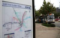 The Metro ArlingtonXpress bus stops at College Park Center in Arlington on Nov. 22.(Rose Baca/Staff Photographer)