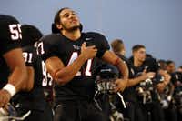 "Euless Trinity linebacker Elikena ""Eric"" Fieilo (47) stands during the National Anthem comes to a close before a game against Keller at Pennington Field on September 26, 2008.(Dallas Morning News file photo)"