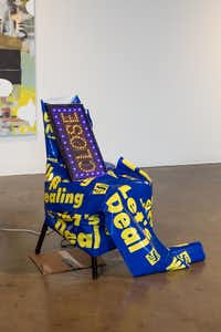 """""""The Sentimentalist (Brick and Mortar),"""" chair, vinyl banner, electric sign & cardboard from the Desktop show by artist Ludwig Schwarz at Conduit Gallery (Kevin Todora/Special Contributor)"""