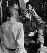 Fidel Castro questioned a man charged with banditry in 1958 during a trial in the guerrillas' base in the Cuban mountain range of Sierra Maestra.(AP)
