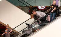 Black Friday shoppers ride an escalator at Galleria Dallas on Nov. 25, 2016.((David Woo/Staff Photographer) )