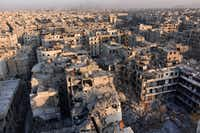 A general view of Aleppo taken from the top of a building in the city's Bustan al-Basha neighbourhood on November 28, 2016, during Syrian government forces assault to retake the entire northern city from rebel fighters. In a major breakthrough in the push to retake the whole city, regime forces captured six rebel-held districts of eastern Aleppo over the weekend, including Masaken Hanano, the biggest of those in eastern Aleppo. AFP/Getty Images