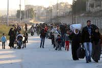 This Sunday, Nov. 27, 2016 photo provided by the Rumaf, a Syrian Kurdish activist group, which has been authenticated based on its contents and other AP reporting, shows people fleeing rebel-held eastern neighborhoods of Aleppo into the Sheikh Maqsoud area that is controlled by Kurdish fighters, Syria. Syrian state media is reporting that government forces have captured the eastern Aleppo neighborhood of Sakhour, putting much of the northern part of Aleppo's besieged rebel-held areas under state control. (The Rumaf via AP)AP