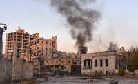 Smoke billows in Aleppo's Bustan al-Basha neighbourhood on November 28, 2016, during Syrian pro-government forces assault to retake the entire northern city from rebel fighters. Government forces have retaken a third of rebel-held territory in Aleppo, forcing nearly 10,000 civilians to flee as they pressed their offensive to retake Syria's second city. In a major breakthrough in the push to retake the whole city, regime forces captured six rebel-held districts of eastern Aleppo over the weekend, including Masaken Hanano, the biggest of those in eastern Aleppo.AFP/Getty Images