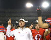 SMU head coach Chad Morris stands with his players as the school song is played following SMU's 75-31 loss during the Navy Midshipmen vs. the SMU Mustangs NCAA football game at Ford Stadium in Dallas on Saturday, November 26, 2016. (Louis DeLuca/The Dallas Morning News)(Staff Photographer)