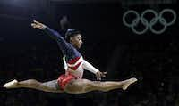 In this Aug. 9, 2016 file photo, United States' Simone Biles performs on the balance beam during the artistic gymnastics women's team final at the Summer Olympics in Rio de Janeiro, Brazil. Many of the Olympics' most memorable moments have come courtesy of African-American women athletes who have accounted for more than a dozen medals in 14 days of competition. (AP Photo/Rebecca Blackwell, File)(AP)
