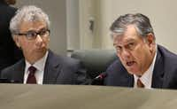 Dallas City Manager A.C. Gonzalez (left) and Mayor Mike Rawlings during a council session. (Louis DeLuca/Staff Photographer)