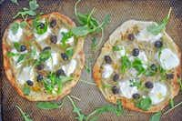 Artichoke and ricotta pizzas Ellise Pierce
