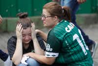 Fans of Brazil's soccer team Chapecoense mourned outside the Arena Conda stadium in Chapeco, Brazil, on Tuesday. (Andre Penner/The Associated Press)