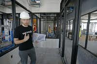 Adam Wacenske, general manger of the WeWork's south region, shows off WeWork's two-floor future coworking space on McKinney Avenue in Uptown.(Jae S. Lee/Staff Photographer)
