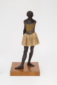 """The Little Fourteen Year Old Dancer"" by Edgar Degas is featured in the new exhibition ""Degas: A New Vision"" at the ""A Cotton Office in New Orleans"" by Edgar Degas is featured in the new exhibition ""Degas: A New Vision"" at the Museum of Fine Arts, Houston(Museum of Fine Arts Houston)"