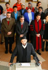 Imam Omar Suleiman (right)of the Valley Ranch Islamic Center in Irving answers questions during a press conference. Clergy and lay leaders from the group Faith in Texas were in attendance and spoke to denounce the post-election targeting of Muslims, undocumented people and people of color during a press conference at the Islamic Association of North Texas in Richardson, Texas, Tuesday, November 29, 2016. (Tom Fox/The Dallas Morning News)Staff Photographer