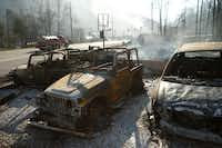 The remains of a Jeep rental business smolders after a wildfire November 29, 2016 in Gatlinburg, Tennessee. Thousands of people have been evacuated from the area and over 100 houses and businesses were damaged or destroyed after drought conditions helped the fire spread through the foothills of the Great Smoky Mountains. (Photo by Brian Blanco/Getty Images)Getty Images