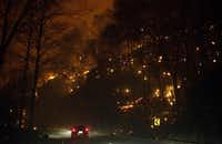 Fire erupts on both side of Highway 441 between Gatlinburg and Pigeon Forge, Tenn., Monday, Nov. 28, 2016. In Gatlinburg, smoke and fire caused the mandatory evacuation of downtown and surrounding areas, according to the Tennessee Emergency Management Agency. (Jessica Tezak/Knoxville News Sentinel via AP)AP
