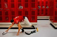 Steele Downing, a 16-year-old junior at Lovejoy High School, reaches for a shoe as he switches from his normal prosthetic limb to an athletic one in a locker room November 4, 2008 at the Lucas, Texas school. When he was nine, Downing, a defensive and offensive lineman for the Lovejoy Leopards, had his left leg amputated below the knee after suffering from a bone disease since childbirth. Not to be deterred, Downing has played football since the seventh grade and, recently, picked up soccer about two years ago. <i>Steele is one of so many stories I've been able to cover that has completely inspired me, a reminder that no matter what life throws at me, there's always a way to overcome.</i>(G.J. McCarthy/Staff Photographer)