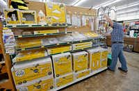 General manger Danny Stanford works in the beekeeping section at the new Rooster Home & Hardware store in Dallas (Jae S. Lee/The Dallas Morning News)