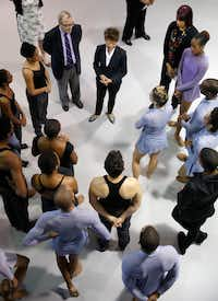 Dr. Gary Gibbs, executive director of the Texas Commission on the Arts (top left in suit) and Chu (center) talk to dancers in the Dallas Black Dance Theatre (Nathan Hunsinger/Staff Photographer)