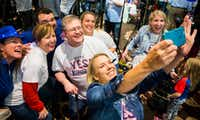 Andrea Proctor takes a selfie as supporters of a proposed new stadium for the Texas Rangers celebrate as they realized a referendum on Nov, 8 would pass.  (Ashley Landis/The Dallas Morning News)Ashley Landis/The Dallas Morning News
