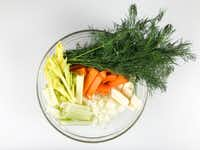 Aromatic vegetables — carrots, onions, celery, parsnip — and dill are key ingredients in traditional chicken soup.(Leslie Brenner/Staff)
