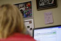 A motivational card on the wall and photos of her family hang in front of Tarrant County CPS child-abuse investigator Kelli Bailey's desk in Fort Worth, Texas June 21, 2016.  (Nathan Hunsinger/The Dallas Morning News)(Staff Photographer)