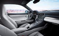 The three-spoke steering wheel has a small dial that can be turned to normal, sport, sport-plus and individual settings for the suspension, steering, transmission and engine.(Porsche)