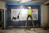 The area around the open grill is taped while work continues on the newest Fogo de Chao restaurant. (Andy Jacobsohn/The Dallas Morning News)(Andy Jacobsohn/Staff Photographer)