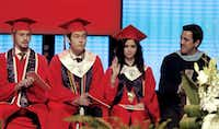 Prior to delivering her speech, Valedictorian Larissa Yanin Martinez waves to the crowd as she is introduced on stage during the McKinney Boyd High School Commencement ceremony at Prestonwood Baptist Church on Friday, June 3, 2016, in Plano, Texas. With her are (from left) Baron Phillips, Senior Class student council Vice President; Salutatorian Anthony Zhang Liu; and Cruz Saenz, Associate Principal of the school.(Jae S. Lee/The Dallas Morning News)