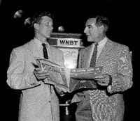 Ted Mack, right, master of ceremonies for  <i>The Original Amateur Hour</i>, looks over sheet music with singer Pat Boone in New York in 1953.  (DMN file/AP)