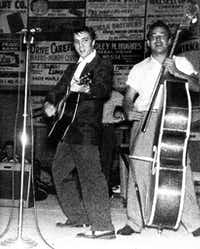 A young Elvis Presley jams with bassist Bill Black at the Big D Jamboree in an undated photo.  ((DMN file))