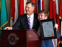 Dallas Mayor Mike Rawlings presented Trent Kreslins, 23, a senior at OU, with a plaque at City Hall on Oct. 28. (David Woo/Staff Photographer)