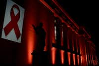 The National and Kapodistrian University of Athens is illuminated with a red light by the Hellenic Center for Disease Control & Prevention, on the eve of the World AIDS Day on November 30, 2016. World AIDS Day is marked worldwide annually on December 1st, to raise awareness of the global AIDS pandemic caused by the spread of HIV infection. / AFP PHOTO / ARIS MESSINISARIS MESSINIS/AFP/Getty Images(AFP/Getty Images)
