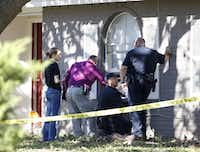 Police investigate the scene where an Arlington homeowner shot two alleged intruders on December 1, 2016. (Nathan Hunsinger/The Dallas Morning News)