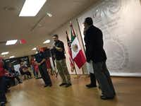 Dallas police officers address crowd at Mexican consulate, assuring them they are not federal immigration officers. (Ana Azpurua/Staff)