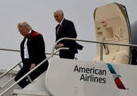 President-elect Donald Trump and Vice President-elect Mike Pence arrive Thursday at the airport before they go on to visit the Carrier air conditioning and heating company in Indianapolis, Indiana.(AFP/Getty Images)