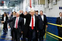 President-elect Donald Trump and Vice President-elect Mike Pence wave as they visit a Carrier factory, Thursday, Dec. 1, 2016, in Indianapolis, Ind. (AP Photo/Evan Vucci)(AP)