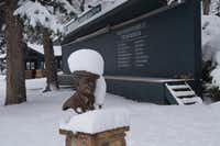 """""""No golf today."""" Snow-capped statue of golf architect Donald Ross, who designed first Broadmoor course in 1918.(John Lumpkin)"""