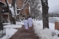 Couple en route to East Tower swimming pool.(John Lumpkin)