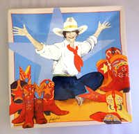 """Cowgirl up with this vivid porcelain platter showing Donna Howell-Sickles' """"World at Her Feet."""" It's from the National Cowgirl Museum and Hall of Fame."""