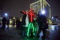 Jennifer Knight (left), Courtney King (bottom), Kimme Paley and Anna Hwang posed for a photo with light guy Juan Galvan during the Reliant Lights Your Holidays show in the Arts District in downtown Dallas on Dec. 13, 2013.(Tom Fox/The Dallas Morning News)