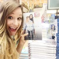 Dallas-based photographer Jess Barfield poses with a copy of Magnolia Story, a book published in October 2016 by Chip and Joanna Gaines and Mark Dagostino. Barfield grew up in Fort Worth and lives in Dallas. She took the photo on the cover of the New York Times and Amazon best-selling book about the stars of HGTV's Fixer Upper home improvement show from Waco, Texas. (Courtesy photo Jess Barfield)