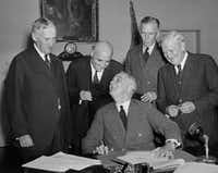 President Franklin D. Roosevelt signs America's first peacetime draft law in the Cabinet Room of the White House in Washington Sept. 16, 1940. Standing from, left, are, Secetary of War Henry L. Stimson; Rep. Andrew J. May, D-Ky., House Military Affairs Committee Chairman; Gen. George C. Marshall, Army Chief of Staff; and Sen. Morris Sheppard, D-Texas, Senate Military Committee Chairman.  (AP Photo) (AP)
