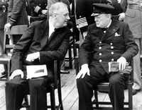 President Franklin D. Roosevelt, left, and British Prime Minister Winston Churchill confer after church services aboard the battleship Prince of Wales during the Atlantic Conference at Argentia Bay off Newfoundland in this  Aug. 10, 1941 file photo.  (AP Photo/FILE) (AP)