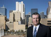 Mike Rawlings, the mayor of Dallas, stood in front of the city landscape last month. The city's pension fund for police and firefighters is near collapse and is seeking an immense bailout, a request that threatens to push the city into bankruptcy. ((Cooper Neill/The New York Times))