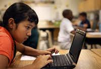 Yesenia Briones, a sixth-grader at Travis Middle School in Irving, uses a netbook during her GT science class. (Kye R. Lee/Staff Photographer)